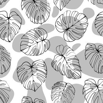 Monstera deliciosa leaf with abstract shape seamless pattern