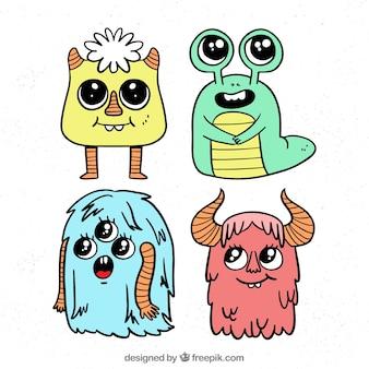 Collezione di personaggi di mostri con facce buffe