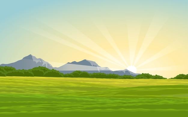 牧草地と山のある田園地帯の朝の時間