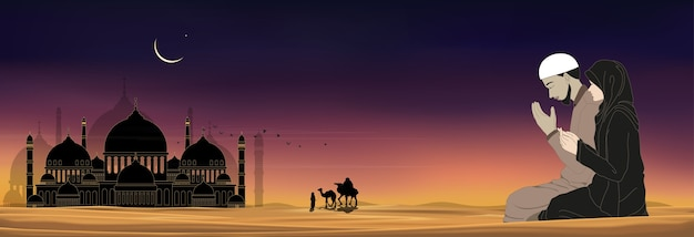 Силуэт мечети с мусульманскими мужчиной и женщиной, молящимися в пустыне