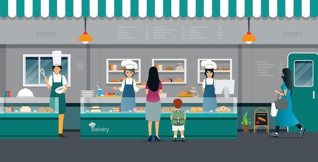母と子はパン屋でパンを買っています