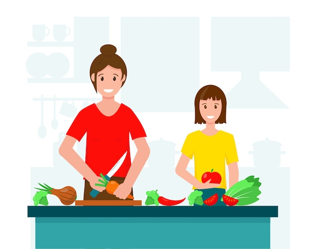 キッチンでサラダを調理する母と娘
