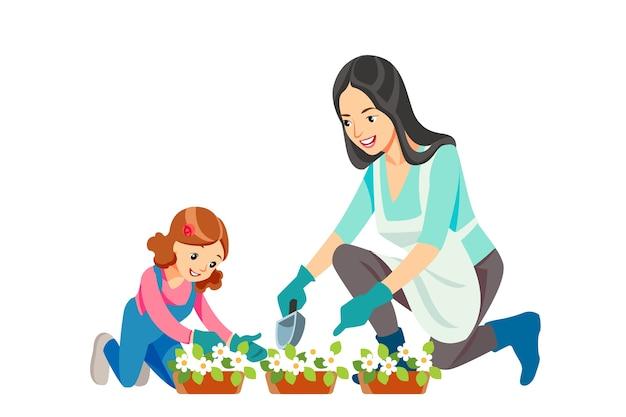 母と娘が一緒に庭に花を植えてガーデニング