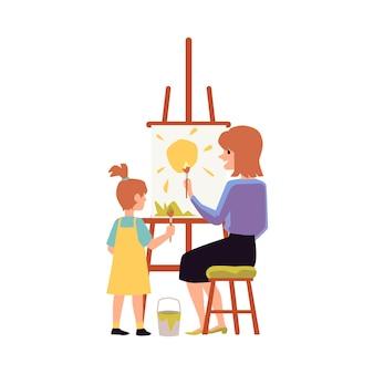 一緒に絵を描くことに熱心な母と娘