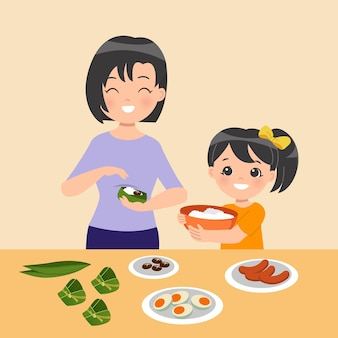 엄마와 딸이 함께 zongzi를 만듭니다.