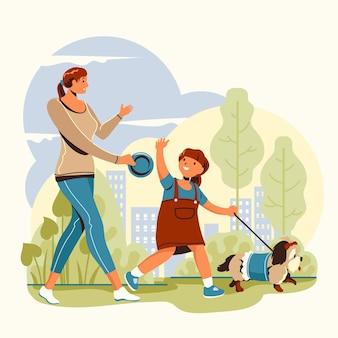 Мать и дочь гуляют с собакой