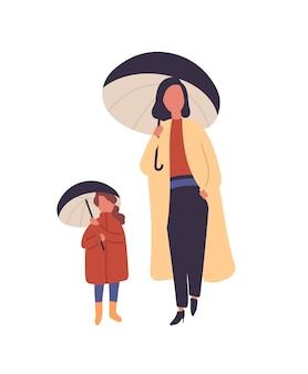 Мать и дочь с зонтиками плоской векторной иллюстрации. мама и ребенок гуляют под дождем, изолированные на белом. женские персонажи, стоящие в осенних модных пальто. осенняя дождливая погода.