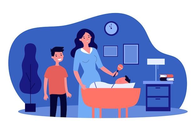 フラットなデザインのゆりかごで赤ちゃんと遊ぶ母と息子
