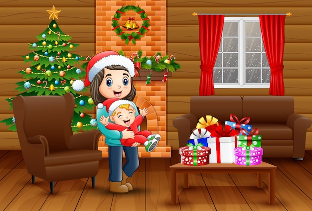 Mother and baby boy celebrating a christmas in the home