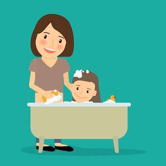 Mother bathing baby girl