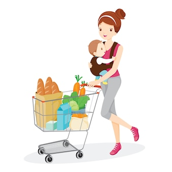 Mother carries baby and pushing shopping cart
