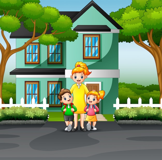 Mother and children in front a house