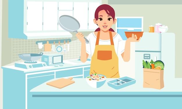 Мать готовит на кухне продукты и еду на кухонном столе и в интерьере кухни