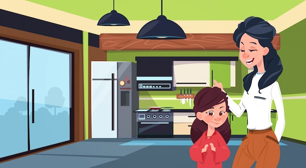 Mother and daughter in modern kitchen over fridge and stove background