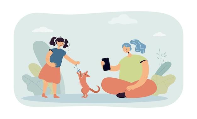 猫と遊ぶ母撮影娘
