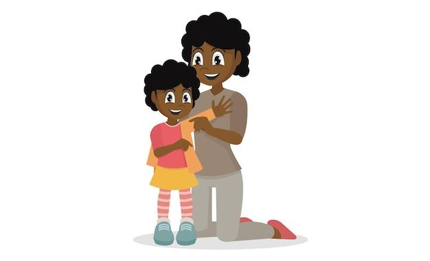 그녀의 아프리카 여자 아이 옷을 입는 것을 돕는 어머니