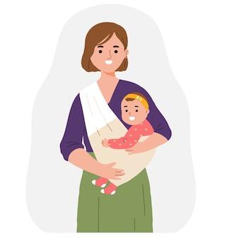 ベビーキャリアを使用して赤ちゃんの娘を保持している母親