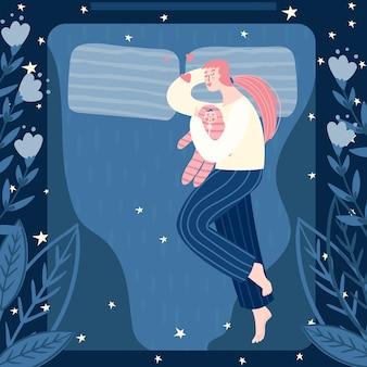 밤에 침대에서 포옹 아이 어머니. 가족 개념.