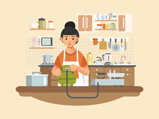 母はキッチンにガスストーブを設置し、キッチン家電とインテリアを背景に
