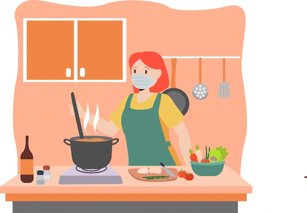 Mother is cooking in the kitchen while keep using medical mask
