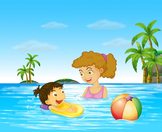 Mother and kid swimming in the ocean
