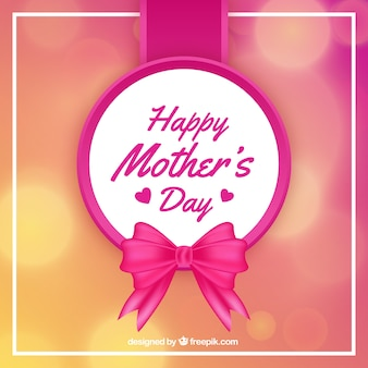 Mother's day background with ribbon and blurred effect