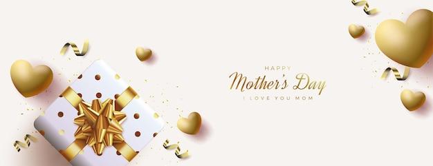День матери баннер с подарочной коробкой и золотыми шарами.