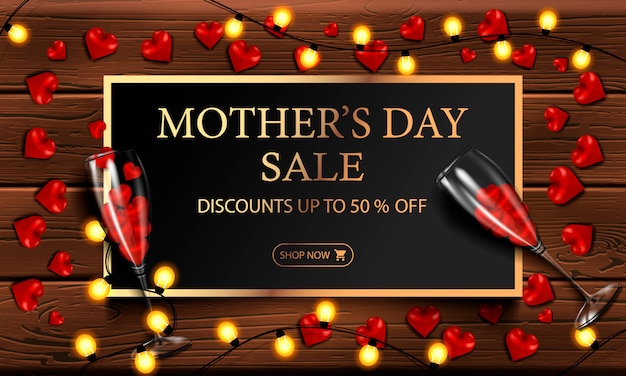 Mother's day sale, discount, modern horizontal banner or poster with a yellow garland, glasses with hearts and a gold frame with inscriptions on a wooden background, vector illustration