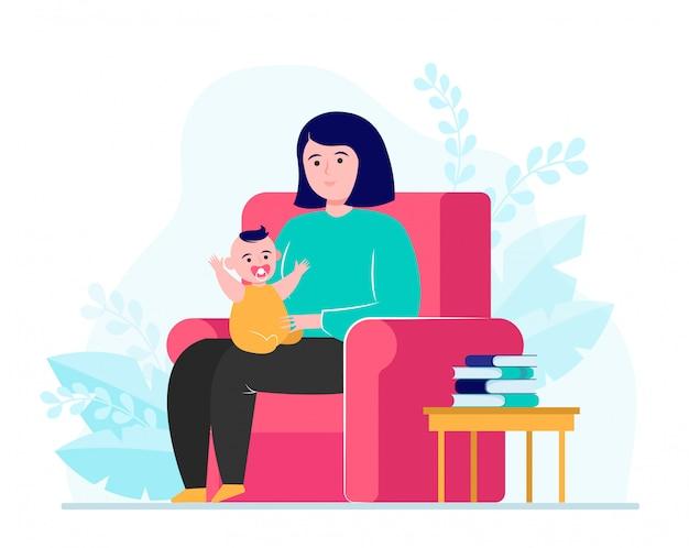 안락의 자에 앉아서 작은 아기를 들고 어머니