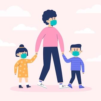Мать гуляет со своими детьми в медицинских масках