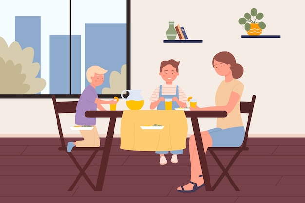 子供を持つ母親は家の部屋で食べる、漫画の幸せな若い女性、台所のテーブルに座っている男の子の子供たち
