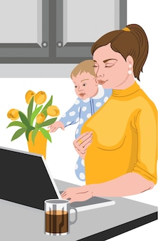 Mother with her baby in her hands working at the laptop