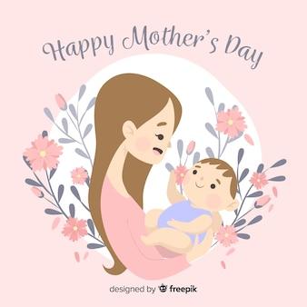 彼女の赤ちゃんの母親の日の背景を持つ母