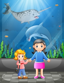 Mother with kid visiting an aquarium