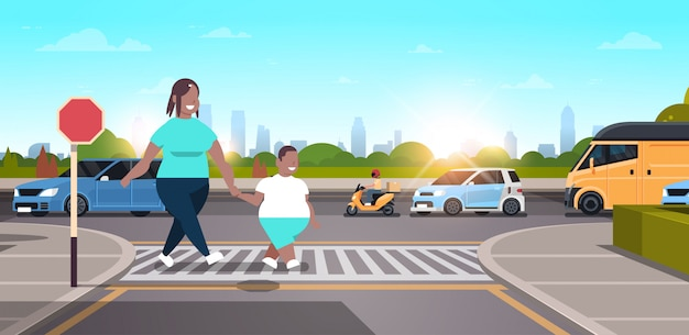 Mother with son walking city urban street   family crossing road on crosswalk concept character full length landscape background horizontal