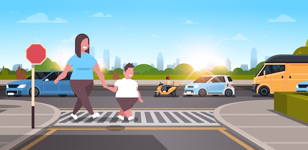 Mother with son walking city urban street  family crossing road on crosswalk obesity concept