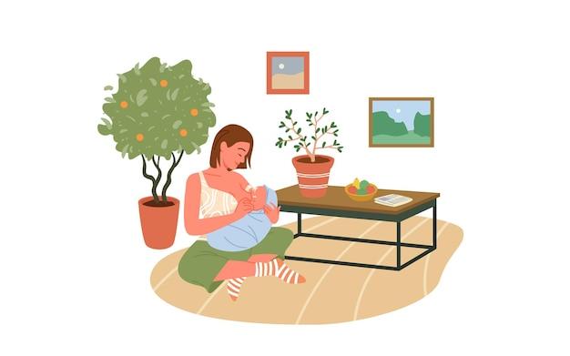 スカンジナビアのヒュッゲのリビングルームのインテリアで母乳育児をしながら、母親は瞑想を落ち着かせる