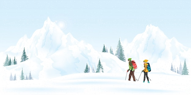 Mountain couple climbers with backpacks walking through heavy snow in winter season.