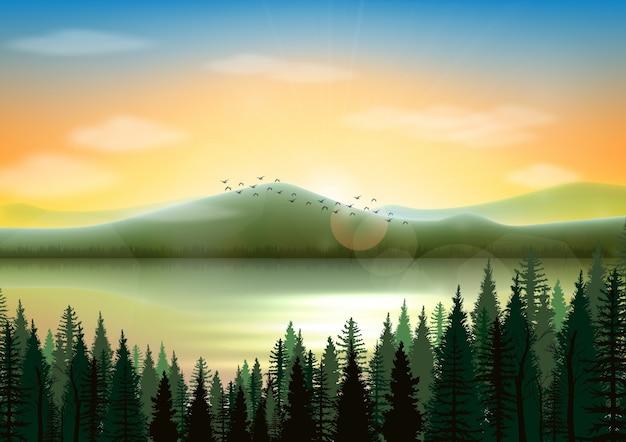 湖と松林を持つ山の風景の背景