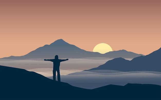 山の頂上に立っている観光客と山の風景