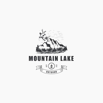 Mountain outdoor with pines and flying ducks logo