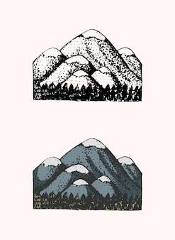 산 봉우리 엠블럼 새겨진 빈티지 손으로 그린 오래된 레이블 또는 배지