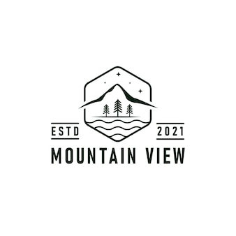 Mountain view logo emblem vector illustration with river, forest, and mountains silhouettes design
