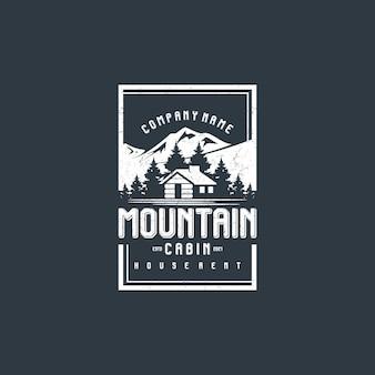 마을 집 임대 로고를 위한 오두막이 있는 산 전망