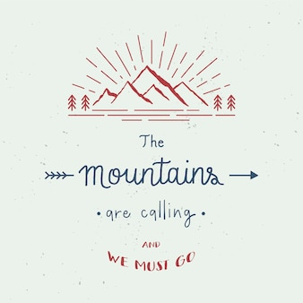 The mountains are calling and we must go hand lettering with abstract watercolor splatters. travel concept.