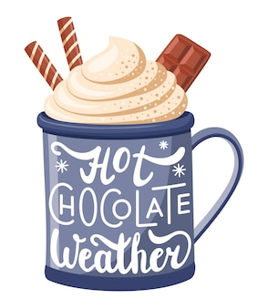 A mug of hot chocolate with cream and chocolate decorated with the words hot chocolate weather.