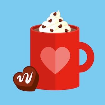 ホットチョコレートのマグカップと一口サイズのハート型チョコレート。