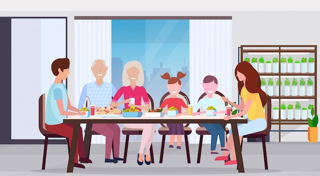 Multi generation family having breakfast people sitting at big round dining table modern kitchen interior smart plants growing system concept flat horizontal full length