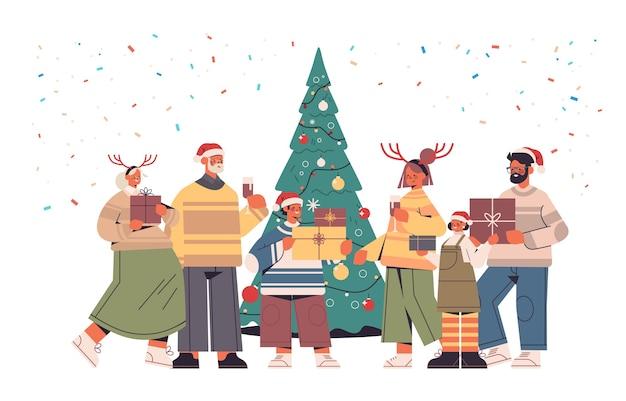 포장 된 선물 상자 새 해 복 많이 받으세요 그리고 메리 크리스마스 휴일 축 하 개념 가로 전체 길이 벡터 일러스트 레이 션을 들고 산타 클로스 모자에 다 세대 가족