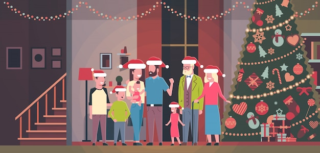 Multi generation family standing together in house near decorated fir tree happy new year merry christmas concept flat horizontal